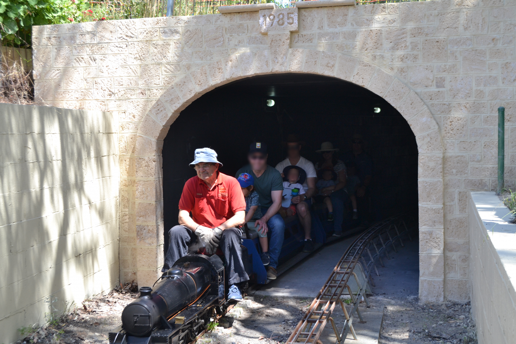 Steve B brings the Black 5 out of the gloom of the tunnel with some smiling punters behind.
