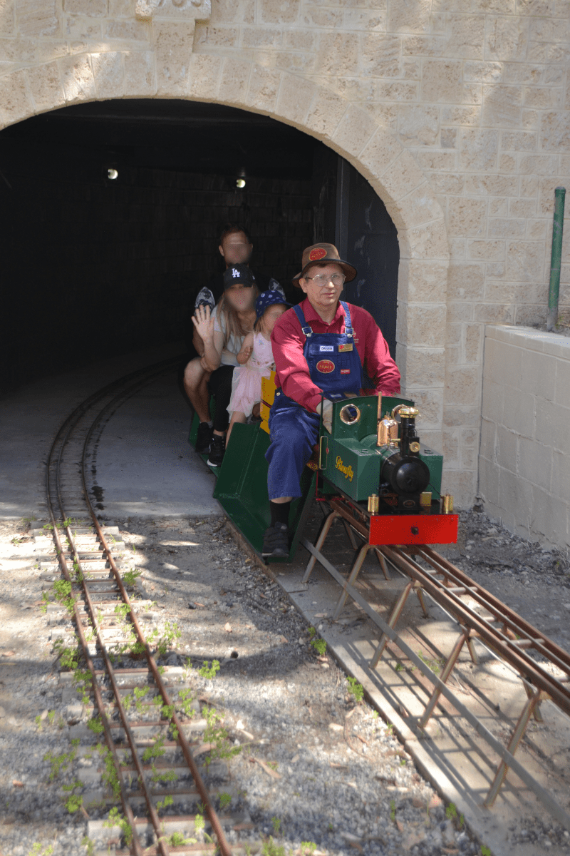 """Steve R and """"Blowfly"""" leave the tunnel with some happy passengers."""