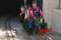 "Steve R and ""Blowfly"" leave the tunnel with some happy passengers."